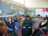 Amy encourages her classmates in the rainbow ring activity