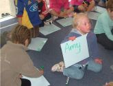 10 April 2008: Amy shows the teacher the whiteboard where she has written her name