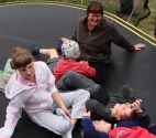 Some of the students relax on the trampoline with Libby