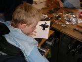 Marshall chooses a bird stencil