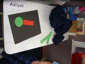 Aaliyah starts her dinosaur shape picture