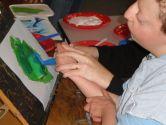 Matthew tries the roller on his bird stencil