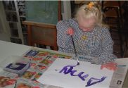 19 June 2008: Amy is painting her name on paper