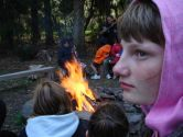 The students enjoy sitting around the outside fire